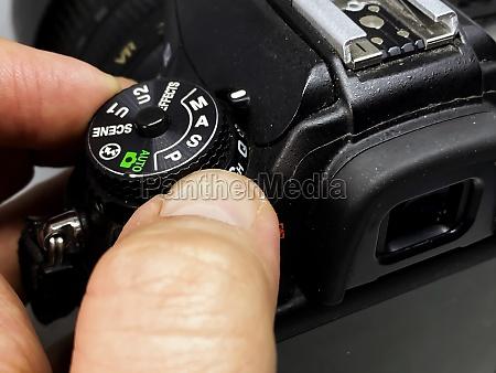 photographer turning the cogwheel to select