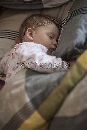 newborn baby sleeping at home