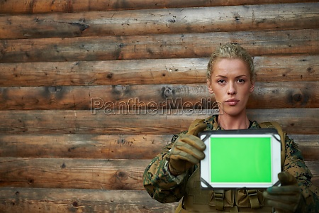 woman soldier using tablet computer