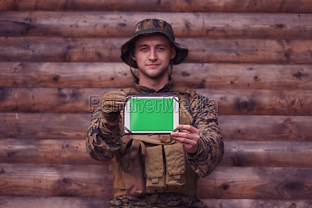 soldier using tablet computer in military