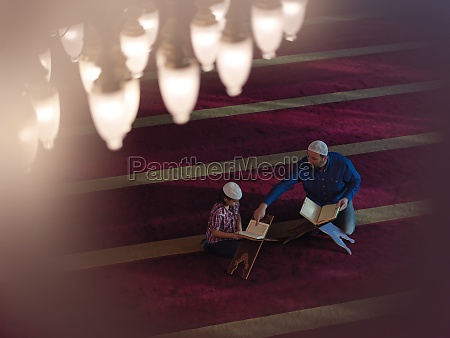 father and son in mosque praying