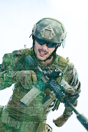 soldier in action aiming laseer sight