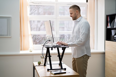 adjustable height desk stand