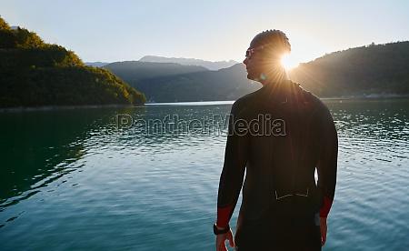 triathlon athlete starting swimming training on