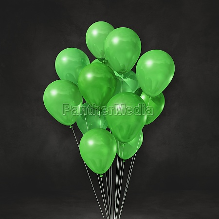 green balloons bunch on a black