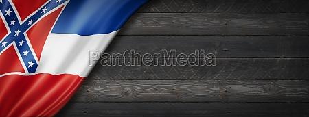 mississippi flag on black wood wall
