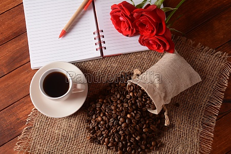 cup of coffee notebook pen and