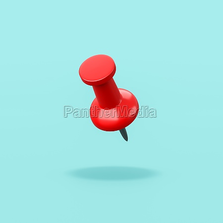 red pushpin on blue background