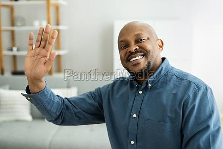 happy man video conference webinar portrait