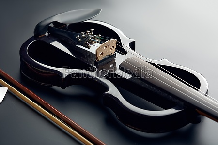 modern electric violin and bow closeup