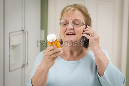 senior adult woman on cell phone