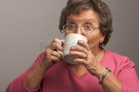 senior woman enjoys her coffee