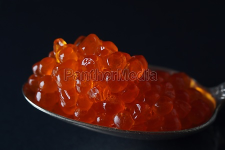 red caviar in a spoon over