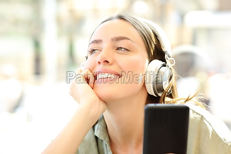 happy woman is listening to music