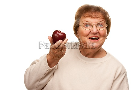 attractive senior woman with red apple