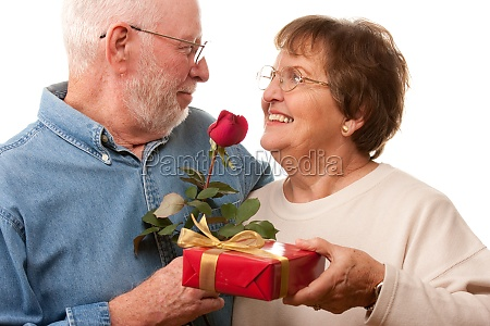 happy senior couple with gift and
