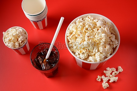 buckets with delicious popcorn on red