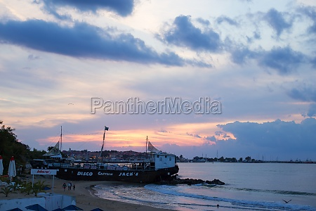 gorgeous sea at sunset beach umbrellas