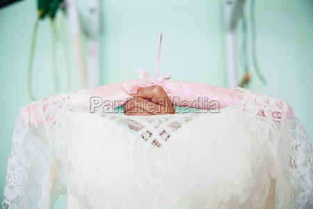 close up of wedding dress hanger
