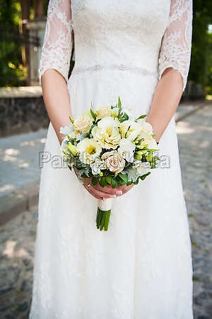 beautiful wedding bouquet in hands of