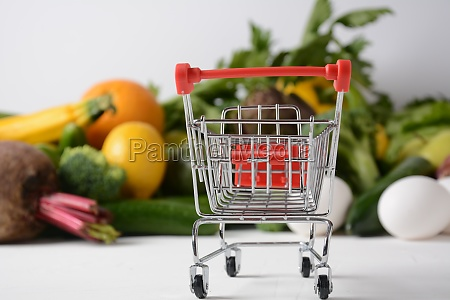 shopping trolley cart and different groceries