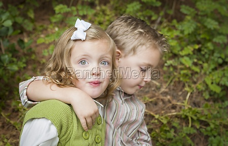adorable brother and sister children hugging
