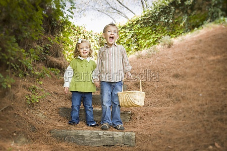 two children walking down wood steps