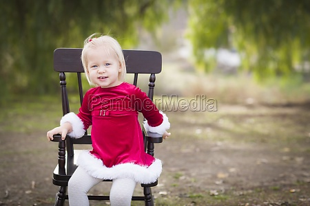 adorable little girl sitting in her