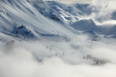 mountain winter landscape with fog and