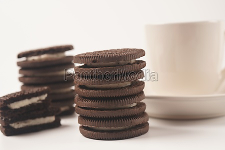 cream round cookies and coffee cup