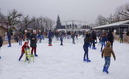 children and adults skating at the