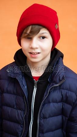 blond boy red snow hat portrait