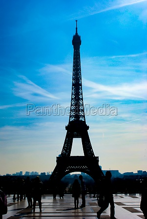 eiffel tower silhouette and the rooftops