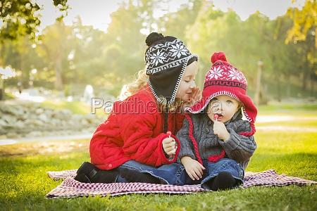 little girl whispers a secret to