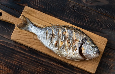 grilled fish on the wooden board