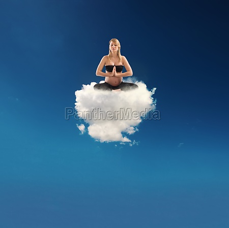 pregnant woman doing yoga on a