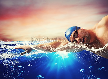 boy swims in a blue deep