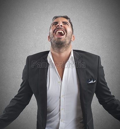 anxious businessman screams