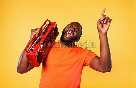 boy ears the music with an