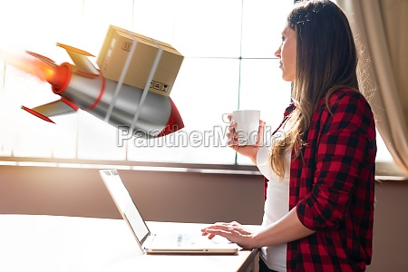 woman does shopping through e commerce
