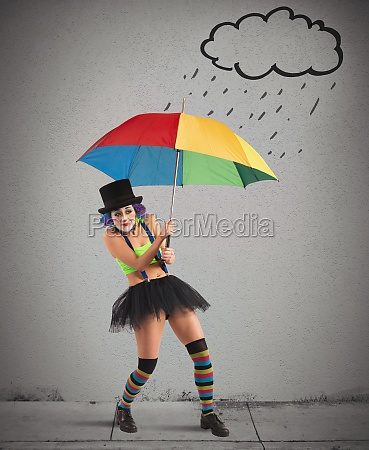 clowns with rainbow umbrella
