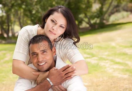 attractive hispanic couple in the park