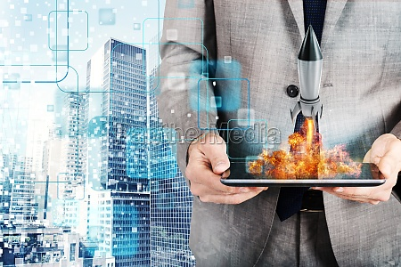 businessman launches rocket from a tablet