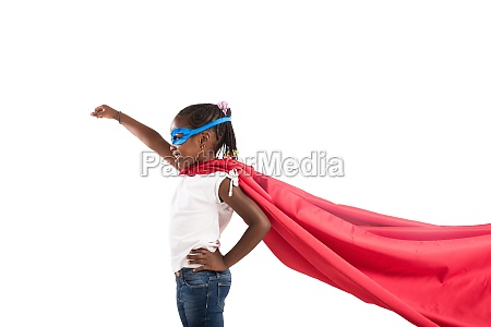 child acts like a superhero to