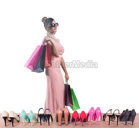 girl full of bags does shopping