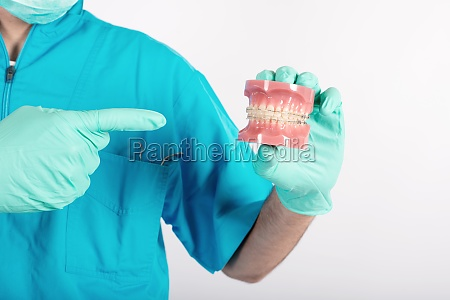 dentist shows how to apply a
