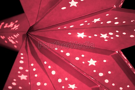 colorful reddish xmas lantern star at