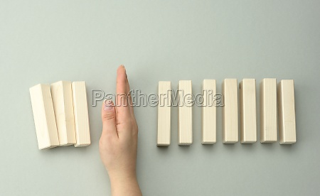 a womans hand between the wooden