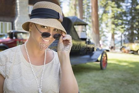 1920s dressed girl near vintage car