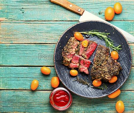 juicy beef steak with kumquat